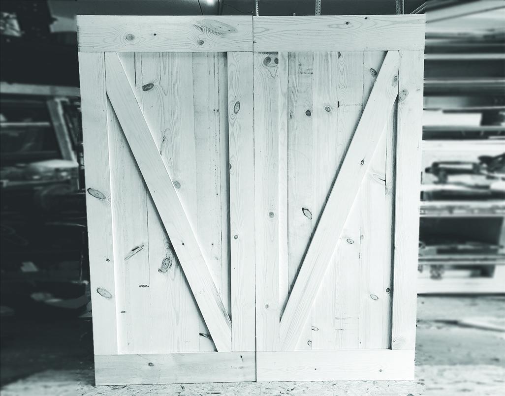 Unfinished barn door in a workshop.