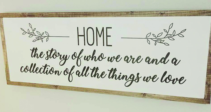 Decorative wood sign that says home.