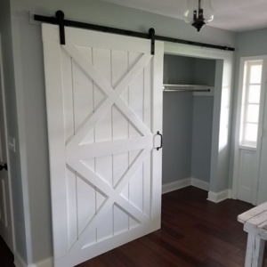 Sliding barn door with double X pattern.